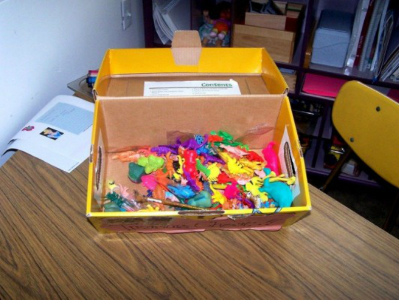 A box filled with toy prizes.